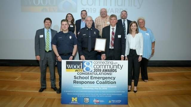 "The group receiving its ""Connecting With Community"" award from WOOD-TV8."