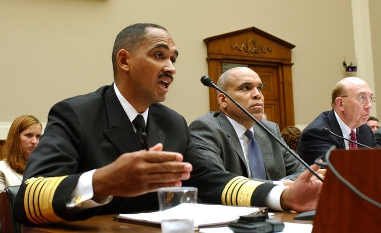 John Agwunobi, left, testifying on Capitol Hill in Washington, Wednesday, Sept. 13, 2006 before the House Energy and Commerce Oversight and Investigations subcommittee. Image: AP Photo/Dennis Cook