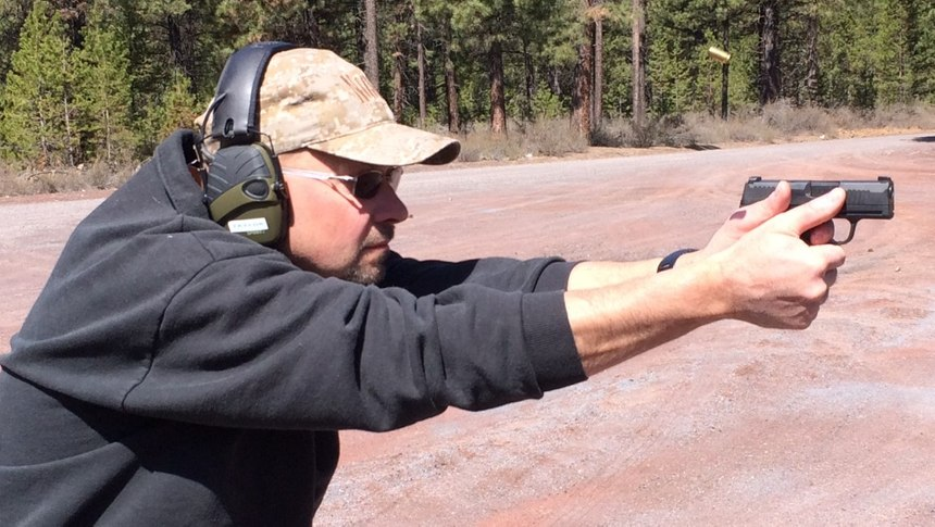 With small handguns, it's critically important to stabilize your shooting platform as much as possible to reduce muzzle rise during recoil. (Photo/Todd Fletcher)