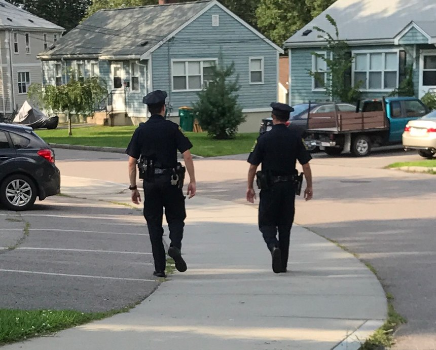 """Walk-and-talks"" have the added benefit of dropping small foot beats into neighborhoods that would not support full-time beats. (Photo/Norwood Police Department)"