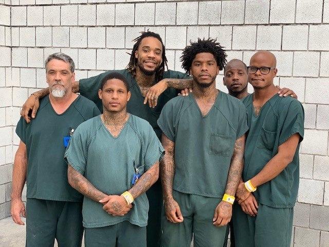 The inmates pictured from left to right helped save Gwinnett County Deputy Patrick Edmond: John Queen, Darius Wilson, Matthew Fountain, Jattir Moton, Rodrequs Wells and Brad Louden
