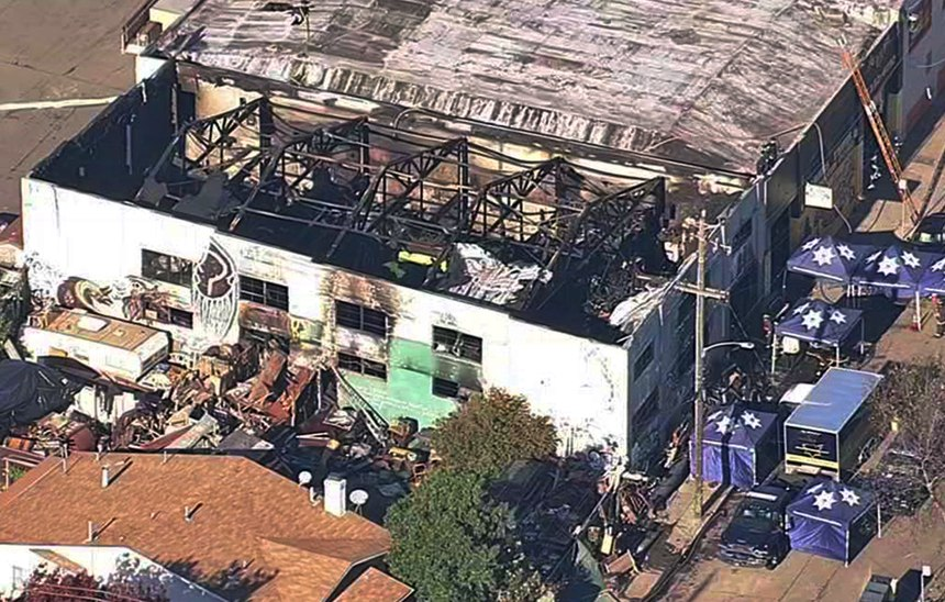An aerial image shows the Ghost Ship Warehouse after a fire swept through the Oakland, California, building. (KGO-TV via AP)