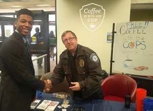University of Akron police Captain Allan Grad interacting with a student at Bierce Library during Coffee With A Cop. (Photo/Jim Gilbride)