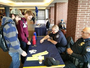 University of Akron Police Major Dale Gooding and Lieutenant Ken Rayl interacting with students at the Student Union. (Photo/Jim Gilbride)