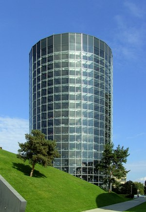 Glass-enclosed car towers allow people to order a car online, insert a specific coin and watch your car automatically descend to the ground, ready for you to drive away – essentially a car vending machine.
