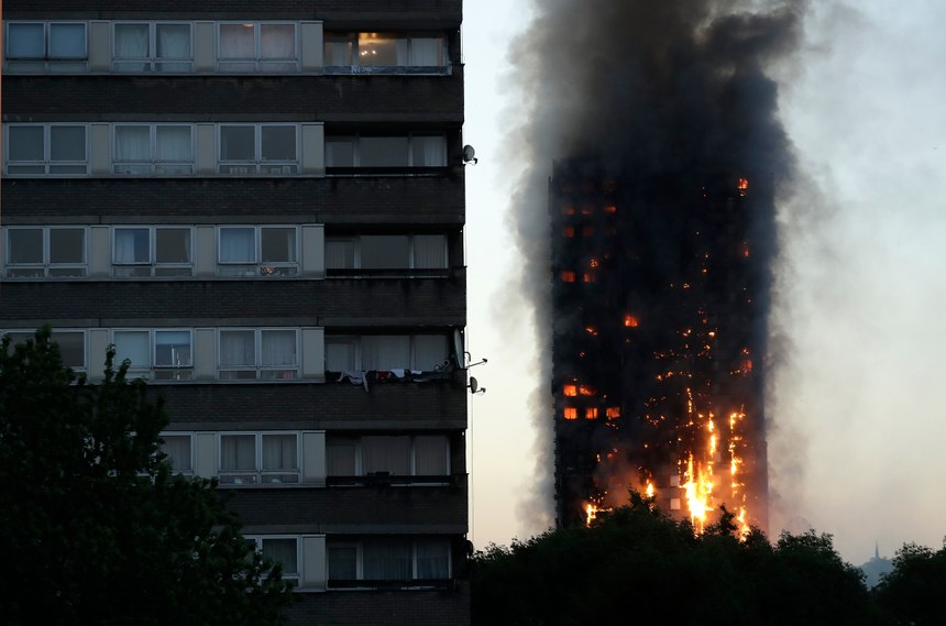 Smoke and flames rise from the Grenfell Tower in London in June 2017. (AP Photo/Matt Dunham)