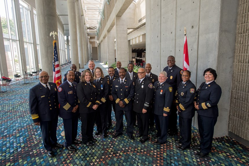 Co-leads Chief John Butler (far left) and Chief Laurie Vandeshoot (far right) pose with members of the second iDELP cohort (2019-2021), which kicked off in August 2019 at the IAFC's Fire-Rescue International conference.