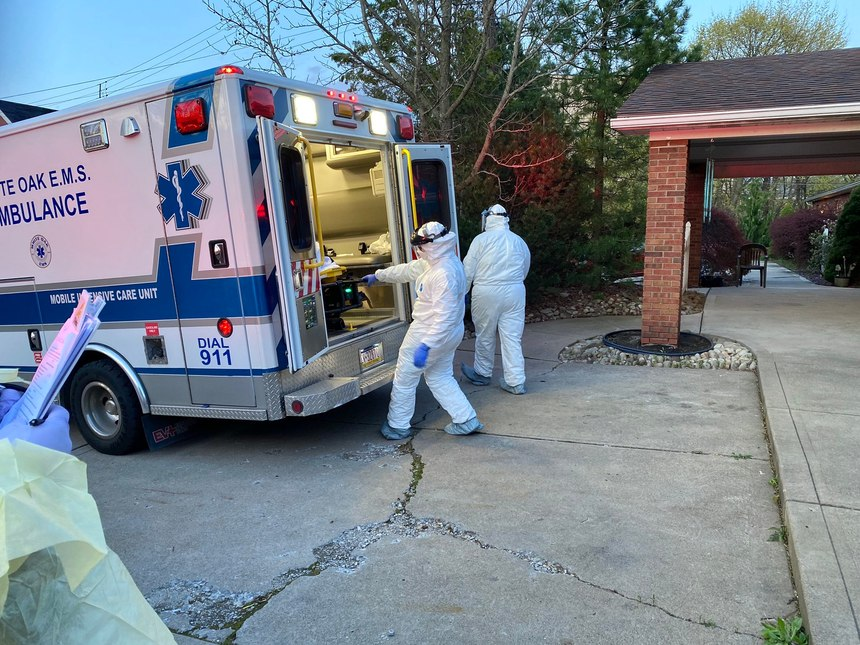 White Oak EMT Kayla Yutzy and Paramedic Maureen Gallagher prepare to pick up a patient from a nursing home facility where residents have tested positive for COVID-19.