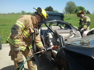 Two Lee's Summit firefighters practice vehicle extrication.