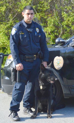 Officer Gomez is pictured here with Hacker, his German shepherd partner, who is not only a police K9, but also a comfort dog.