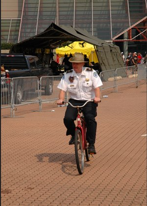 Jacob Oberman, paramedic and field supervisor for the New Orleans Health Department, cycles through a base camp located at the Morial Convention Center in New Orleans during Hurricane Katrina response efforts. (Photo/Miles Jeffery Watts, Jr.)