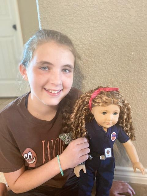 EMT April O'Quinn's niece Lacey with the American Girl doll made in O'Quinn's likeness.