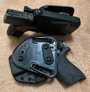 The Safariland Model 7371 thumb release holster.