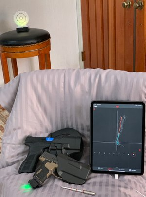 Clockwise from top left, i-MTTS target, iPad with MantisX draw analysis showing a mostly consistent draw, Laser-Ammo SureStrike universal dry-fire cartridge, SIG P365 with Mantis X10 on a magazine base mount, and a KWA ATP with a Laser-Ammo Recoil Enabled AirSoft Laser conversion kit. (Photo/Ron LaPedis)