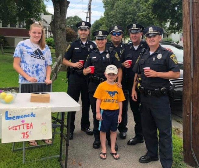 Five-year-old Seamus is pictured with Norwood PD officers.