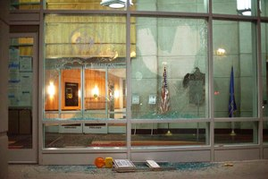 The windows of the Tommy G. Thompson Center on Public Leadership in Madison, Wis. are shattered during demonstrations Tuesday, June 23, 2020. (Emily Hamer/Wisconsin State Journal via AP)