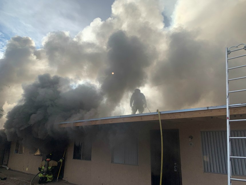 Department members perform a transitional attack on the backside of an apartment as they were getting ready to make entry through the front. Firefighters encountered thick smoke as they were making entry – a great time for early ventilation. (Photos/Mesa Fire and Medical Department)