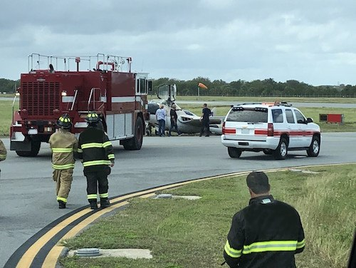 Firefighters were nearly burned, or worse, in the process of trying to push an aircraft back on the runway of an airshow.