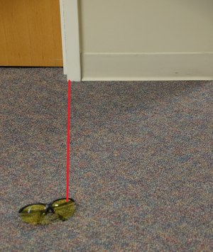The film plane is not parallel to the item of evidence so the viewer cannot see the true distance between the door frame and the item. (Photo/Casson Reynolds)