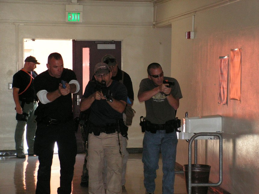 These officers are practicing how to move through a hallway as part of an ad hoc contact team. (Photo/National Training Concepts)