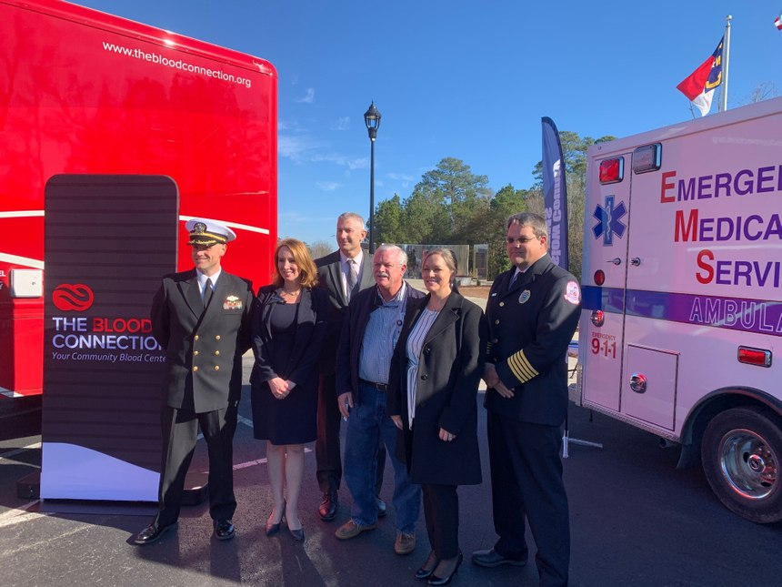 From left to right: Cmdr. Joseph Kotara, Onslow County Camp Lejeune EMS system medical director; Onslow County Manager Sharron Russel; Mike Patterson, The Blood Connection; Dr. Marshall Fink, Onslow County Camp Lejeune EMS system medical director; Trauma Nurse Beverly McAnallen-Szybka, Naval Medical Center Camp Lejeune coordinator; Onslow EMS Division Head David Grovdhal, Onslow County/Camp Lejeune system administrator. (Photo/Onslow County EMS)
