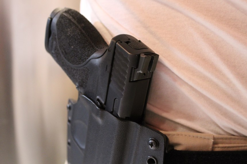 To be considered for concealed carry, a holster must completely cover the trigger while still allowing for a full firing grip on the draw.