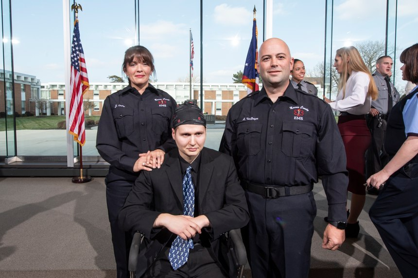 Judy Ortiz and Adam Van Duzen of Morrow County (Ohio) EMS stand next to Ohio State Trooper Jason Phillips at the award ceremony. (Photo/Ohio State Highway Patrol)
