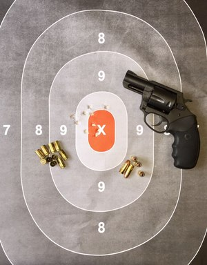 The first ten shots grouped well at 21 feet. The Pitbull fired all kinds of ammunition accurately without fail.