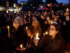 eople hold candles as they gather for a vigil in the aftermath of a deadly shooting at the Tree of Life Congregation, in the Squirrel Hill neighborhood of Pittsburgh, Saturday, Oct. 27, 2018. (AP Photo/Matt Rourke)
