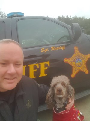 Sergeant Jason Ratcliff pictured with therapy K9 Kit.