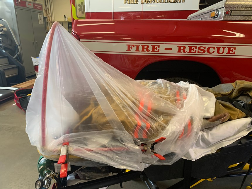 Crews from the Ridgefield (Connecticut) Fire Department developed a device that could be deployed in the field or rapidly attached to a stretcher to provide a protective barrier between patients and the caregivers delivering life-saving interventions.