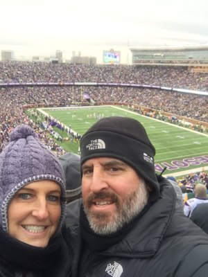 Trunzo and his wife at a football game.
