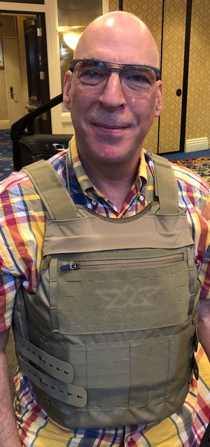 The author is pictured wearing Angel Armor's RISE 2.0 carrier, which has been redesigned for improved comfort.