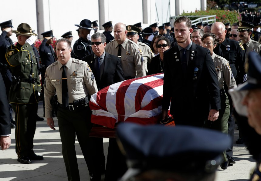 A casket with the body of Ventura County Sheriff's Sgt. Ron Helus is carried into the Calvary Community Church Thursday, Nov. 15, 2018.(AP Photo/Marcio Jose Sanchez, Pool)
