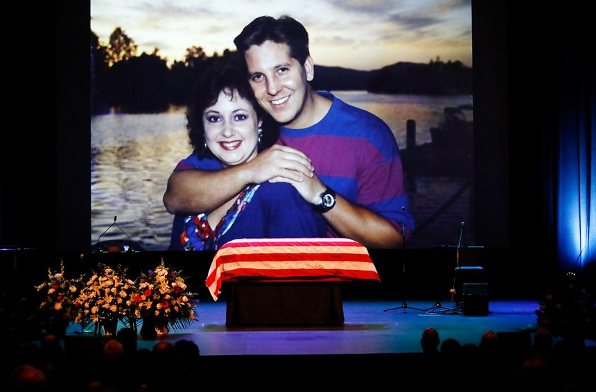A family photo during a video montage of Ventura County Sheriff Sgt. Ron Helus with his wife Karen years ago.(Al Seib /Los Angeles Times via AP, Pool)