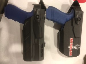 The Safariland duty holsters for compact weapon lights are smaller in profile and more comfortable for the officer, as seen on the right. (Photo/Mike Wood)