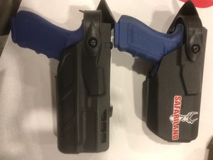 The Safariland duty holsters for compact weapon lights are smaller in profile and more comfortable for the officer, as seen on the right.