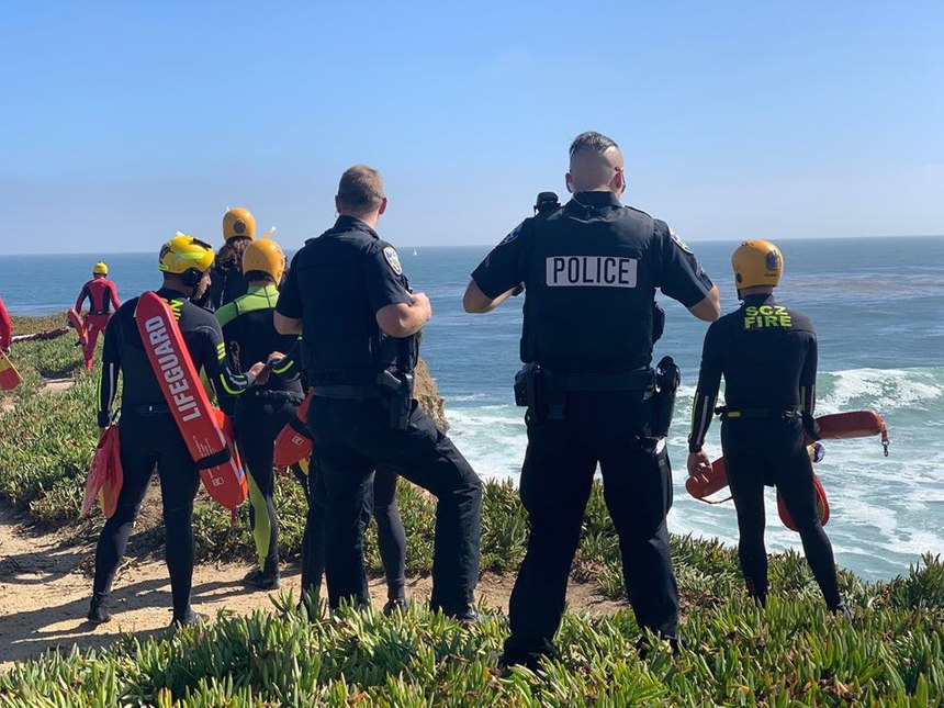 Santa Cruz police officers look out over a cliff where a suspect drove off it and into the ocean on June 30, 2020.(Photo/Santa Cruz Police Department)