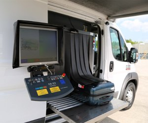 ScanVan operators can open the sliding doors on either side, unfold the conveyor belts, swing out the monitors for viewing the X-ray images and begin scanning within minutes.