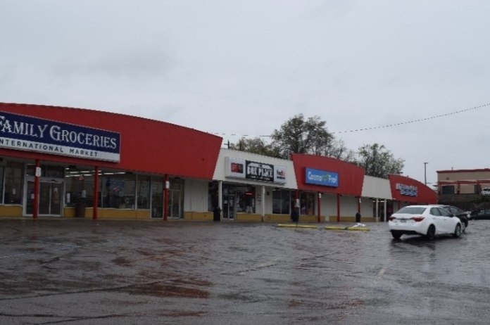Figure 3 shows a typical strip mall interior with a parapet and awning walkway cover. Note this complex was built around 1965 and has changed major retail occupancies many times, once being the home office and lead retail store for a major regional chain of hardware stores.