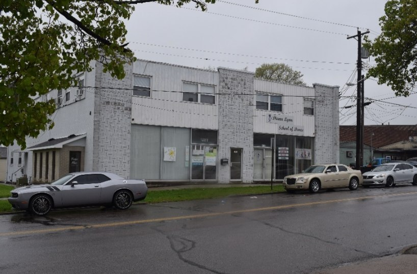Figure 4 illustrates this type of construction began in the early 1950s using techniques developed during World War II. This well-maintained building started with a retail paint and separate home furnishing store with storage in the basement. Now occupied as a physician's office and dance studio, the roof, first and second floors all utilize unprotected open web steel trusses.