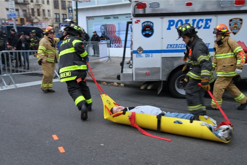 FDNY firefighters and EMTs quickly move a gunshot wounded patient from the warm zone to the ambulance at a full-scale exercise in New York City.