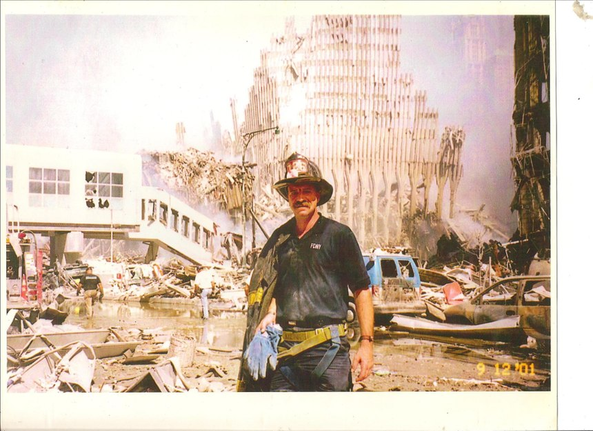 After 9/11, Denis went to Ground Zero to help with search efforts. At one point, he had to go back to his car to get a harness to lower himself into a pit to search for survivors. While going back to the site, he saw a police officer and asked her to take this picture in case he didn't make it out alive.