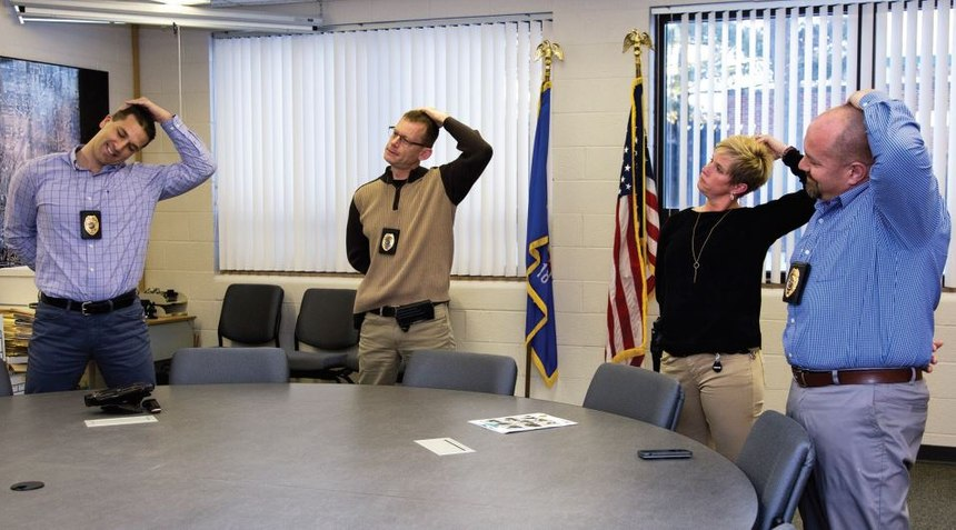 Stretching during briefings is a daily occurrence at SPPD. (Photo/Alan Kolbeck)