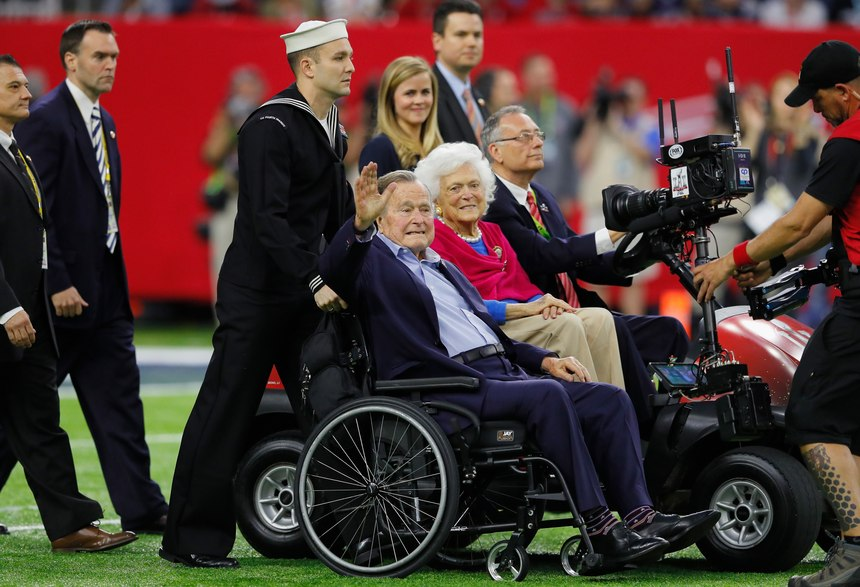 Former President George H.W. Bush and Barbara Bush arrive on the field for the coin toss prior to the NFL Super Bowl LI football game between the New England Patriots and Atlanta Falcons at NRG Stadium on Sunday, February 5, 2017 in Houston, Texas.