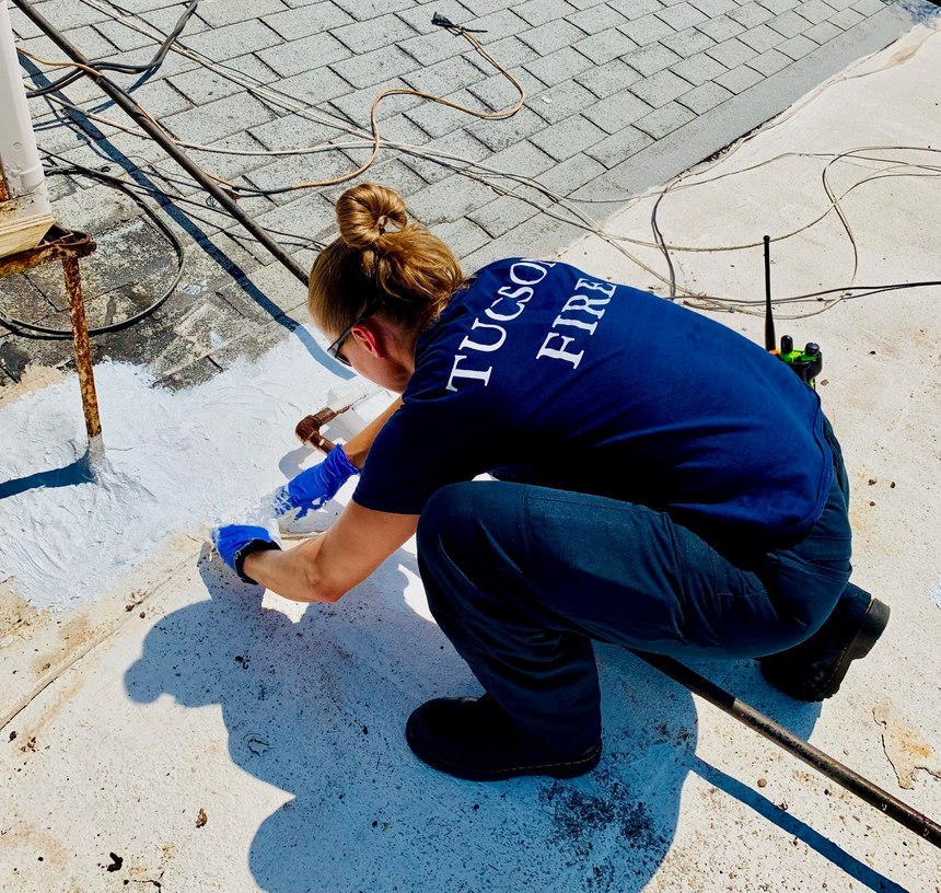 Navigator Jenny La Coss assists in repairing a client's roof.Often when the needs of a client cannot be met conventionally, TC-3 members will use their limited funds to fill unmet client needs.