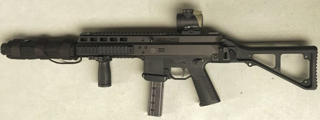 TheSuppressed B&T APC-9 Suomiwith a Trijicon MRO in a Spuhr mount and cover.