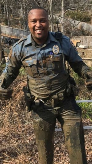 """Toney is pictured in the aftermath of pursuing a wanted suspect through the mud of a drained lakebed. """"He ended up spending hours that night trying to clean all the dirt. He had to take his gun to the range to get them to unpack from where the mud went up in his barrel,"""" Wilson said."""