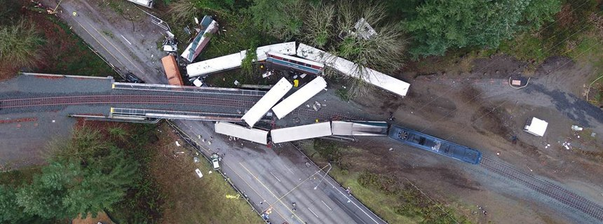 The as-found scene of the Dupont train incident where 11 of 14 rail cars of an Amtrak derailed, killing three people and injuring 62 passengers and 6 crew members.