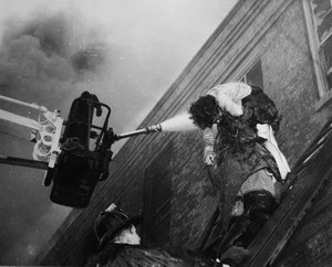 A firefighter removes a victim from Our Lady of the Angels grade school during a fire Dec. 1, 1958, in Chicago.